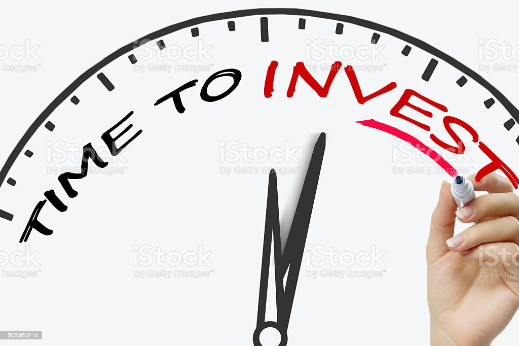 Hand writing Time to Invest concept with red marker on stock photo