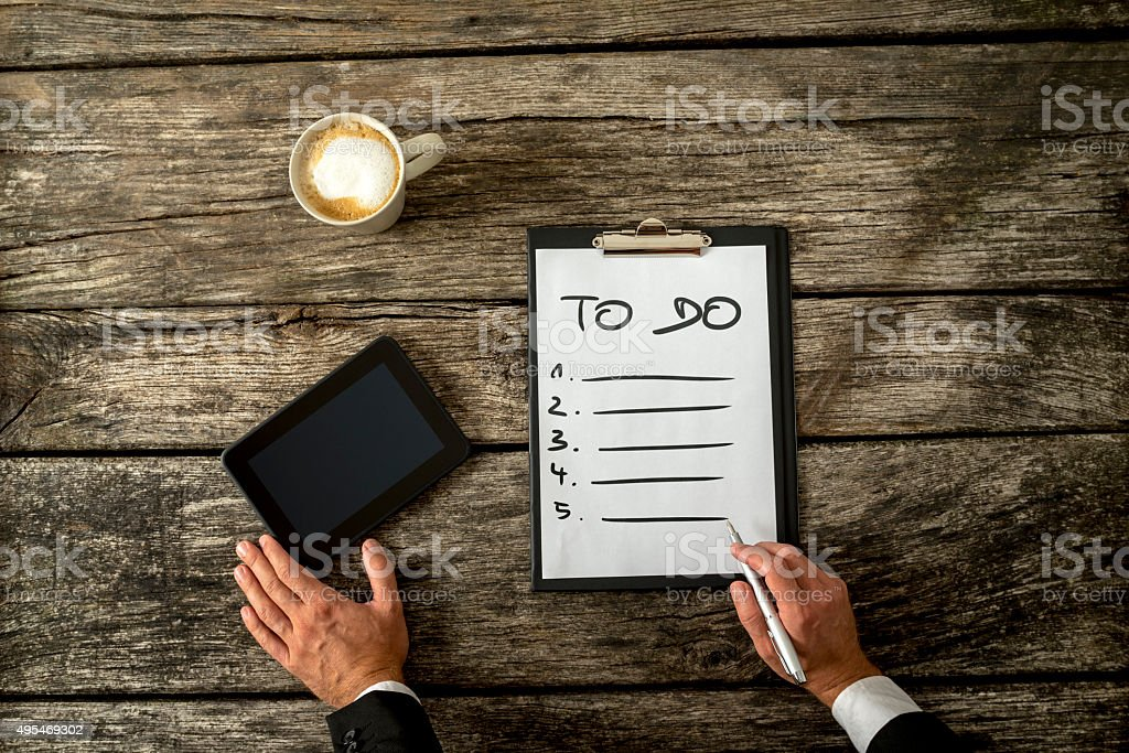 Hand writing  To do list on  white sheet of paper stock photo