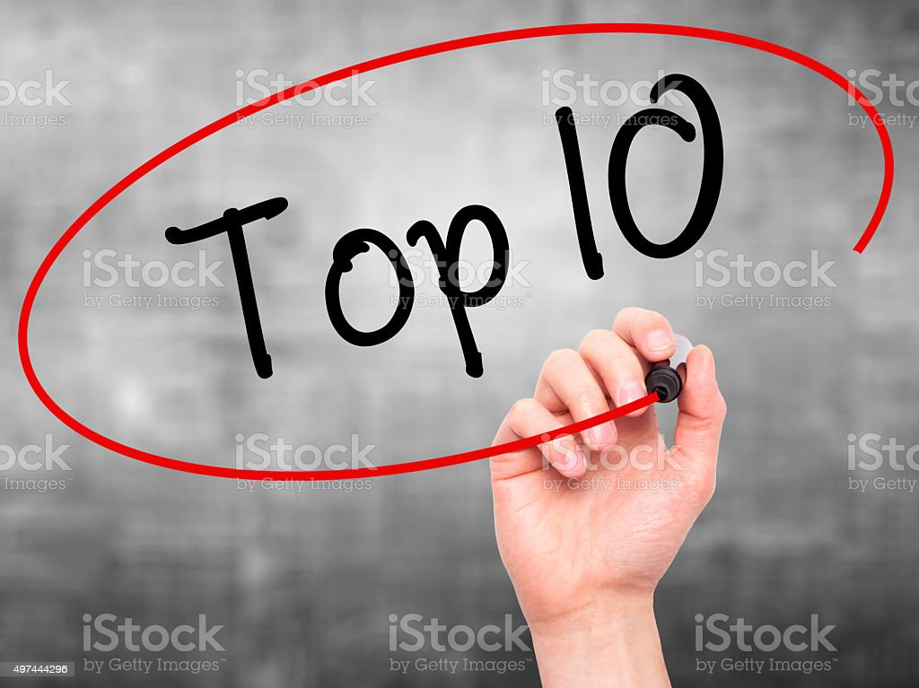 Hand writing Top 10 with marker on visual screen. stock photo
