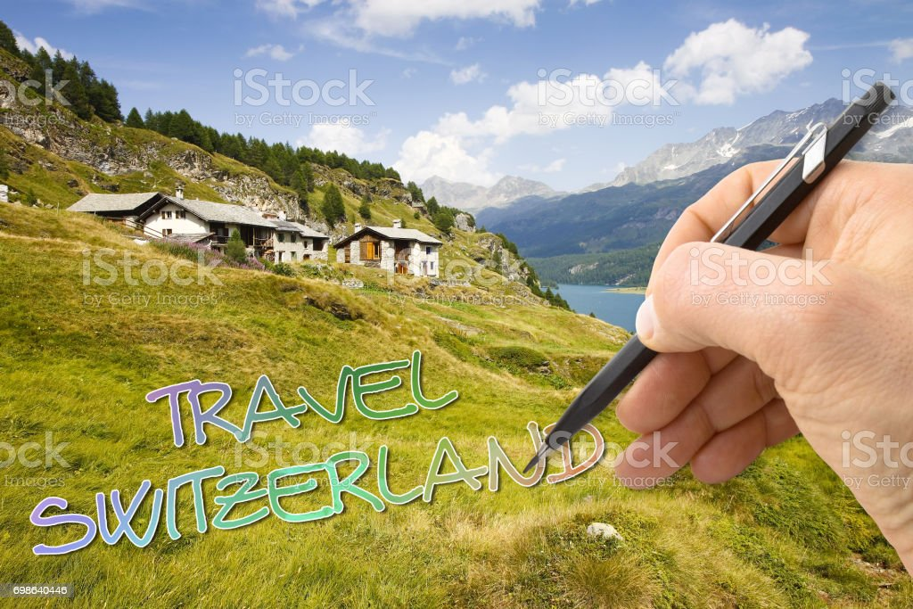 Hand writing 'Travel Switzerland' on switzerland background stock photo