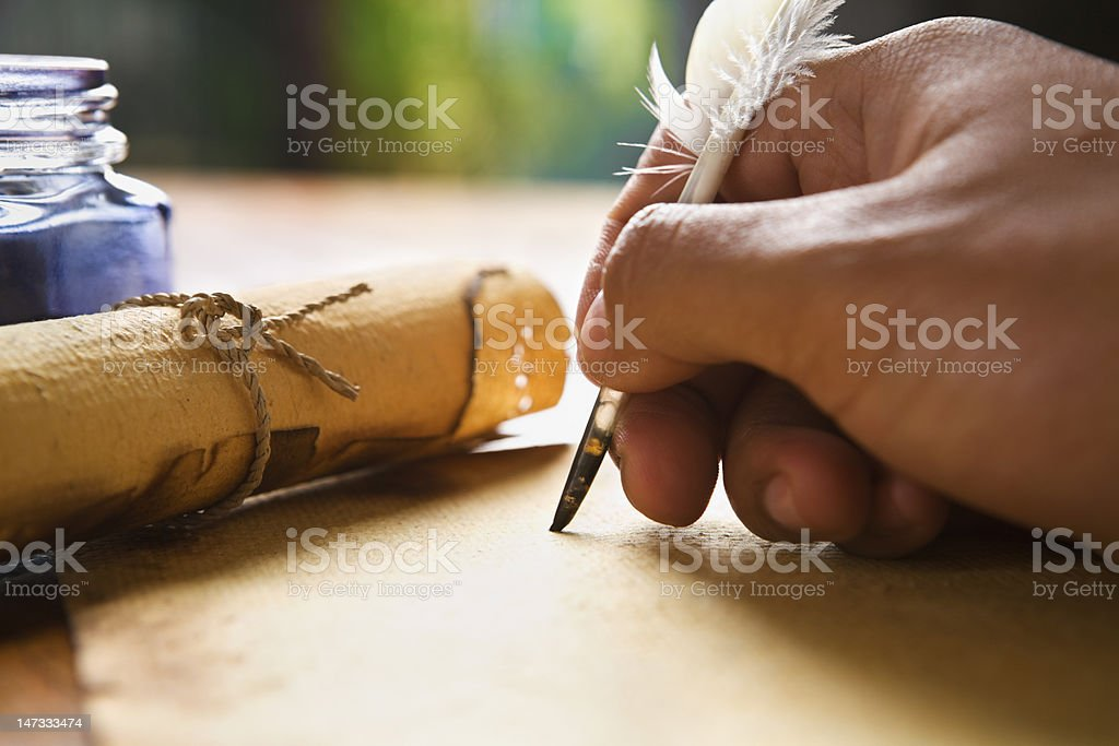 Hand writing using quill pen stock photo