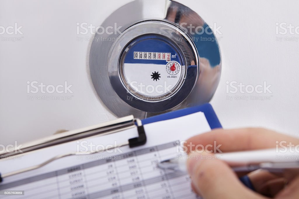 Hand Writing Water Consumption Level royalty-free stock photo