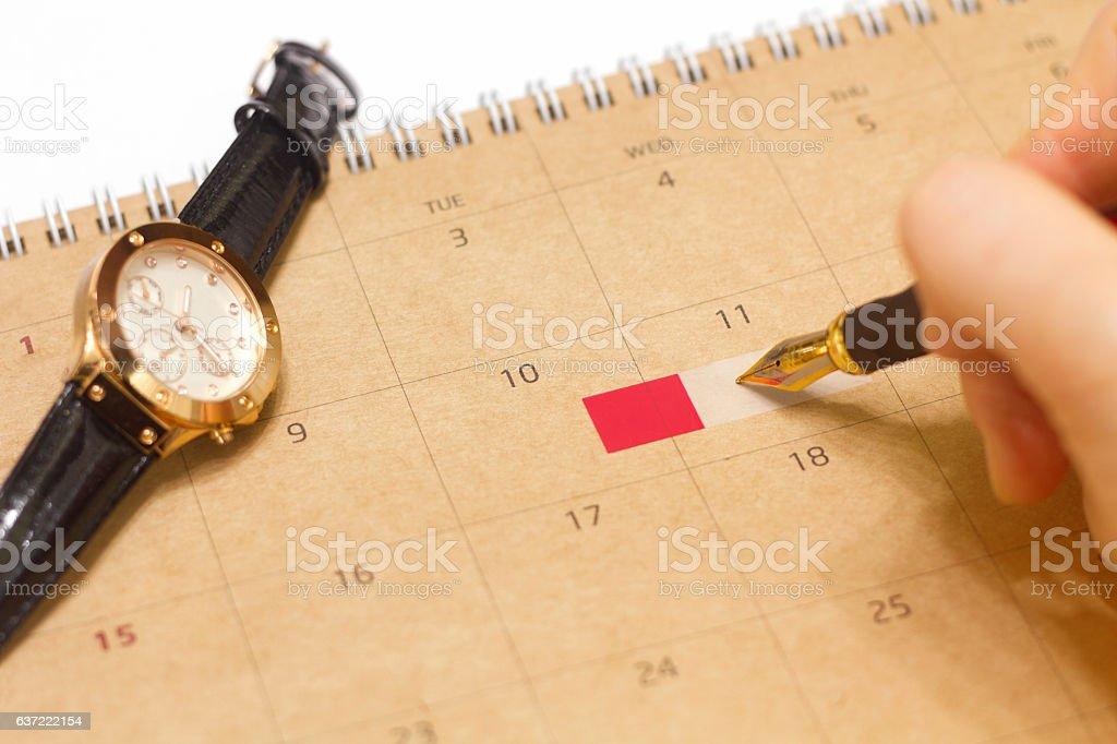 Hand writing work schedule stock photo