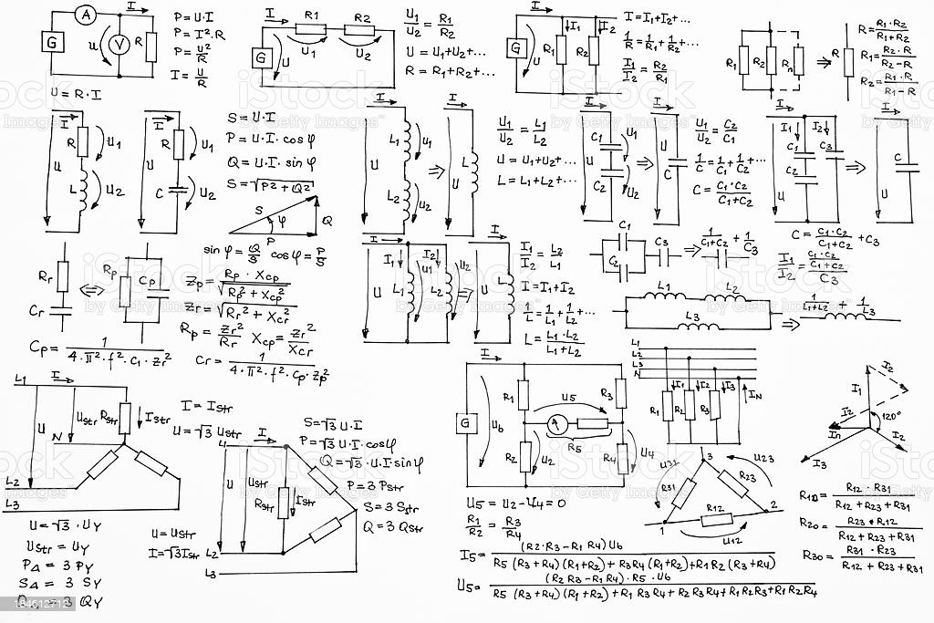 Hand Written Formulas of Electrotechnics and Electronics on White Background stock photo