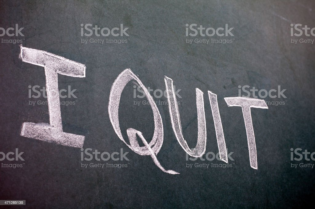 Hand written 'I Quit' on a greenboard royalty-free stock photo