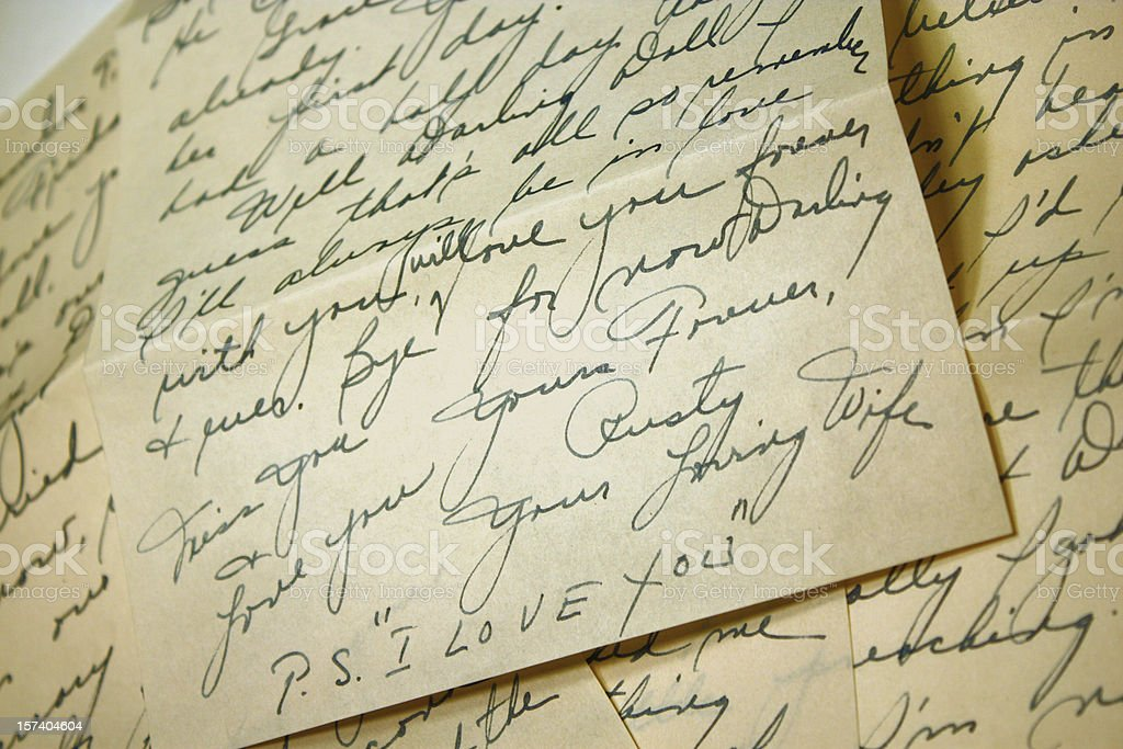 Hand written notes ending in PS I Love You  stock photo