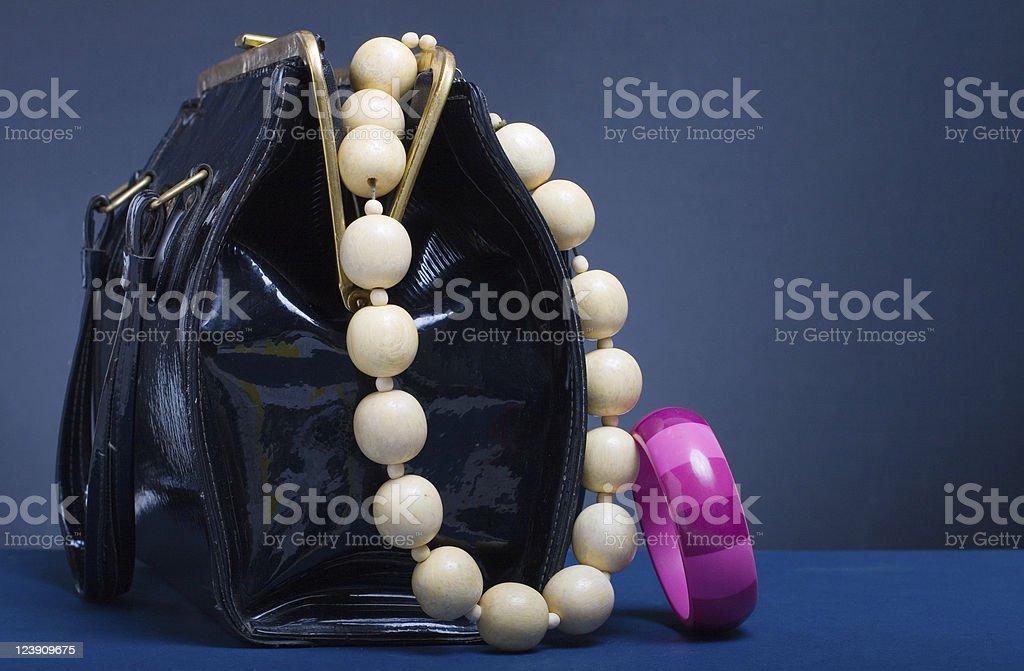 Handbag and jewelry royalty-free stock photo