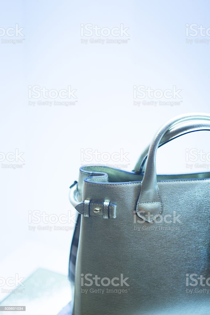 Handbag in fashion store shop window stock photo