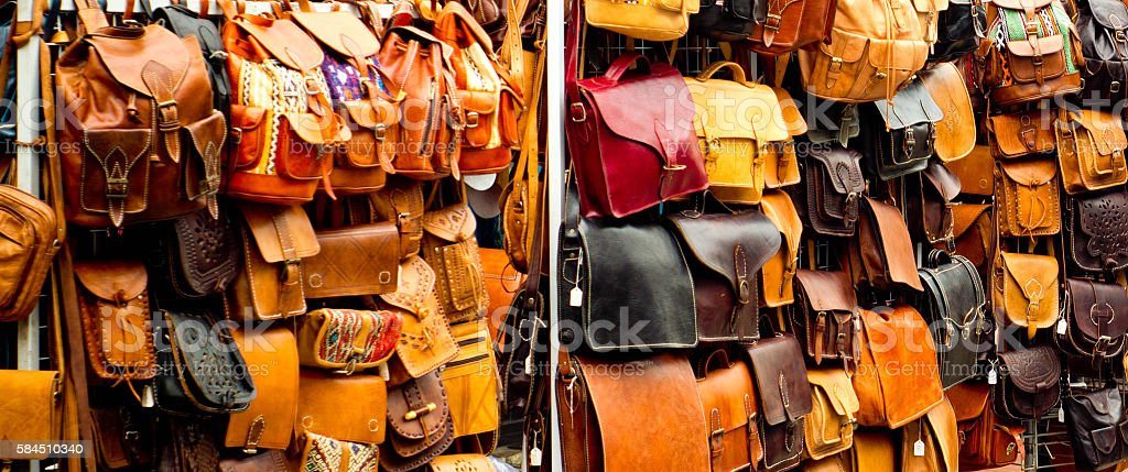 Handbags on a market stall stock photo