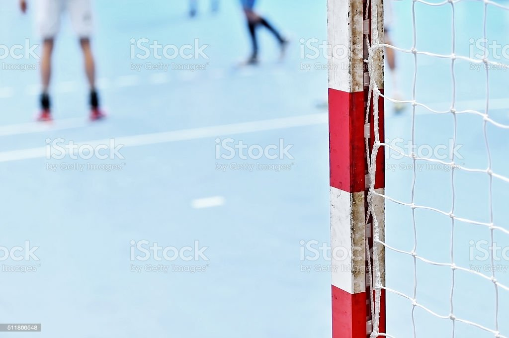 Handball goalpost with players in background stock photo