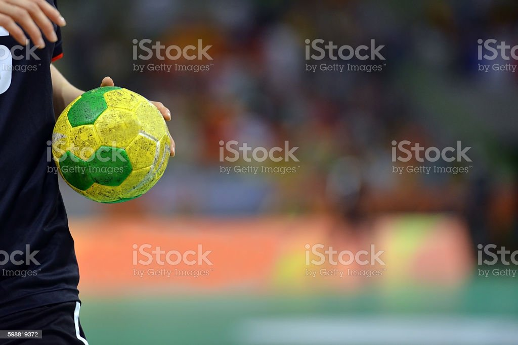 Handball player dribling with a handball stock photo