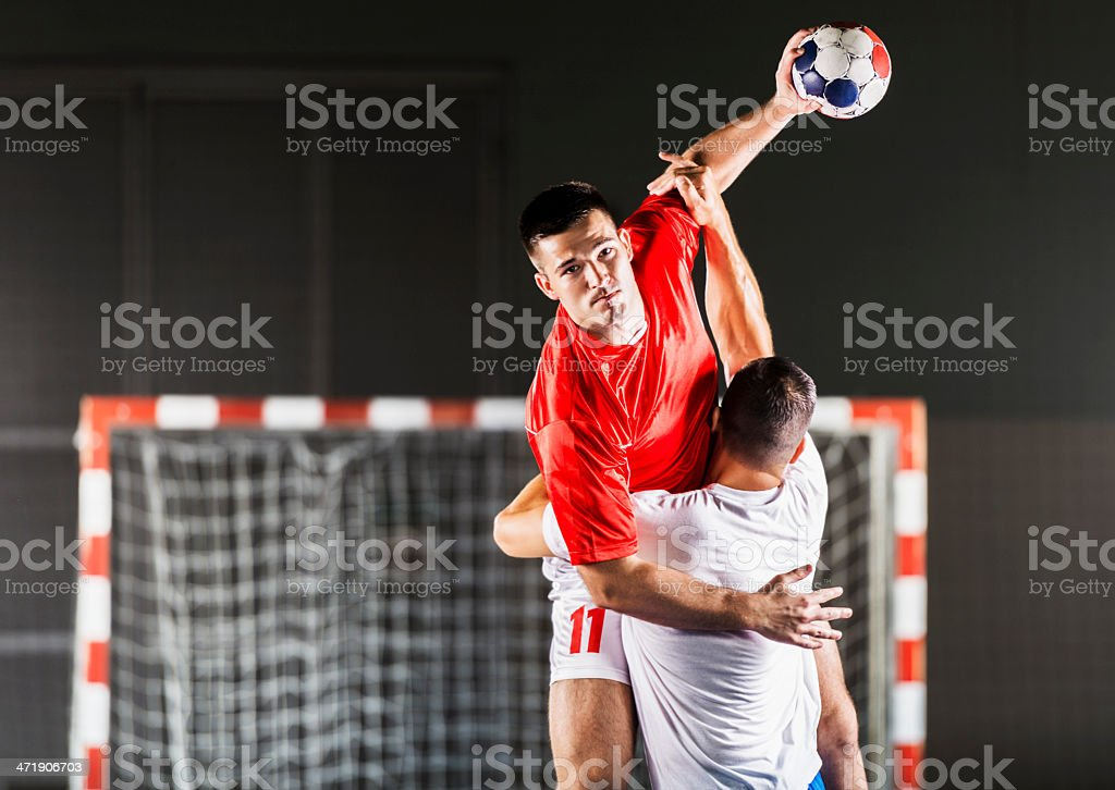 Handball players in action. stock photo