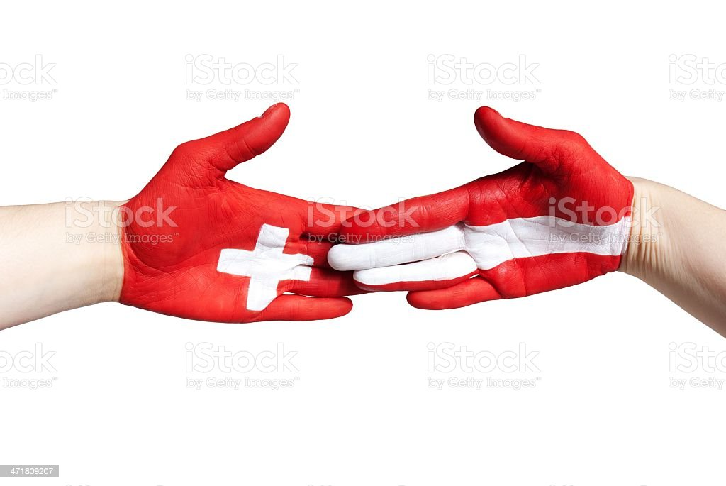 handclap between switzerland and austria royalty-free stock photo