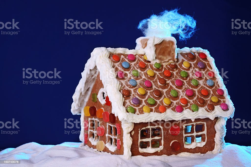 A handcrafted, carefully designed, homemade gingerbread home royalty-free stock photo
