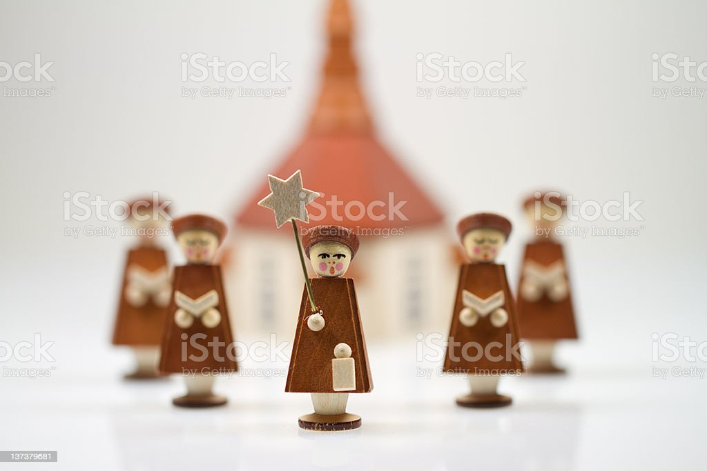 Handcrafted Carolers with white background, produced in Erz Mountains, Germany royalty-free stock photo
