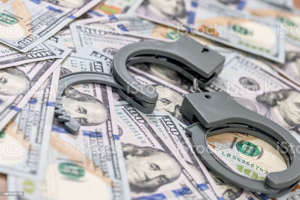 handcuff above usa dollar. close up . stock photo