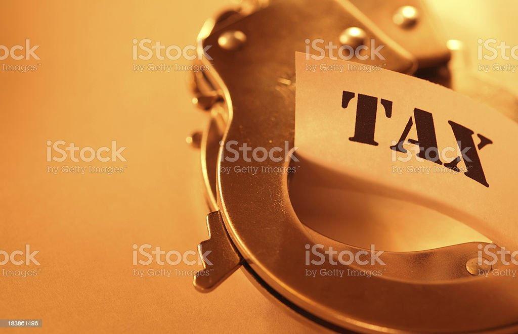 Handcuff and tax stock photo