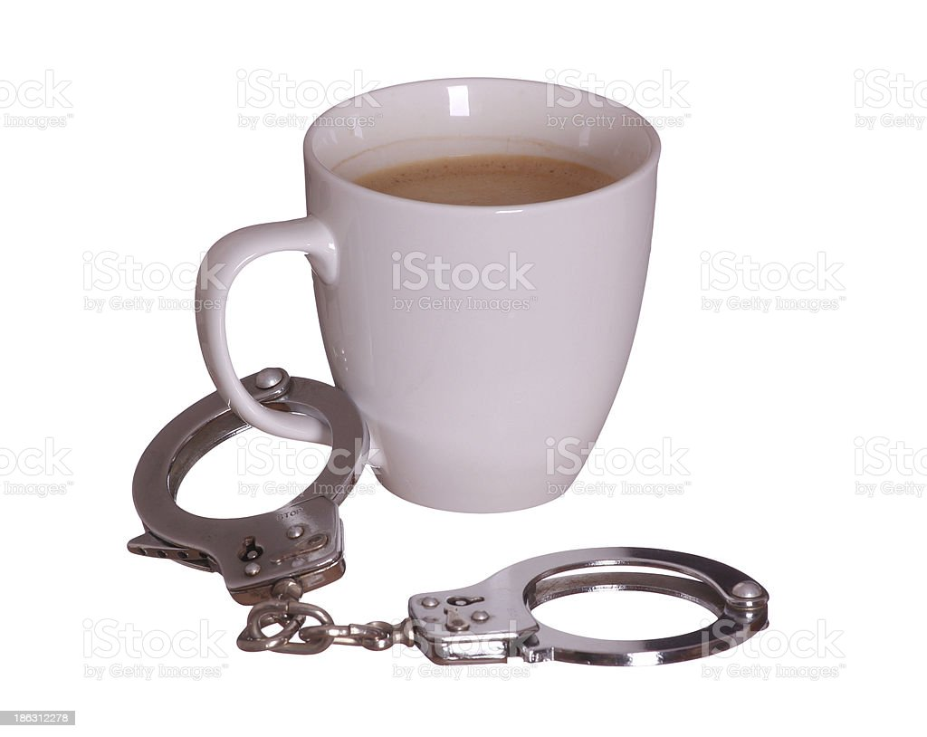 handcuff with coffee royalty-free stock photo