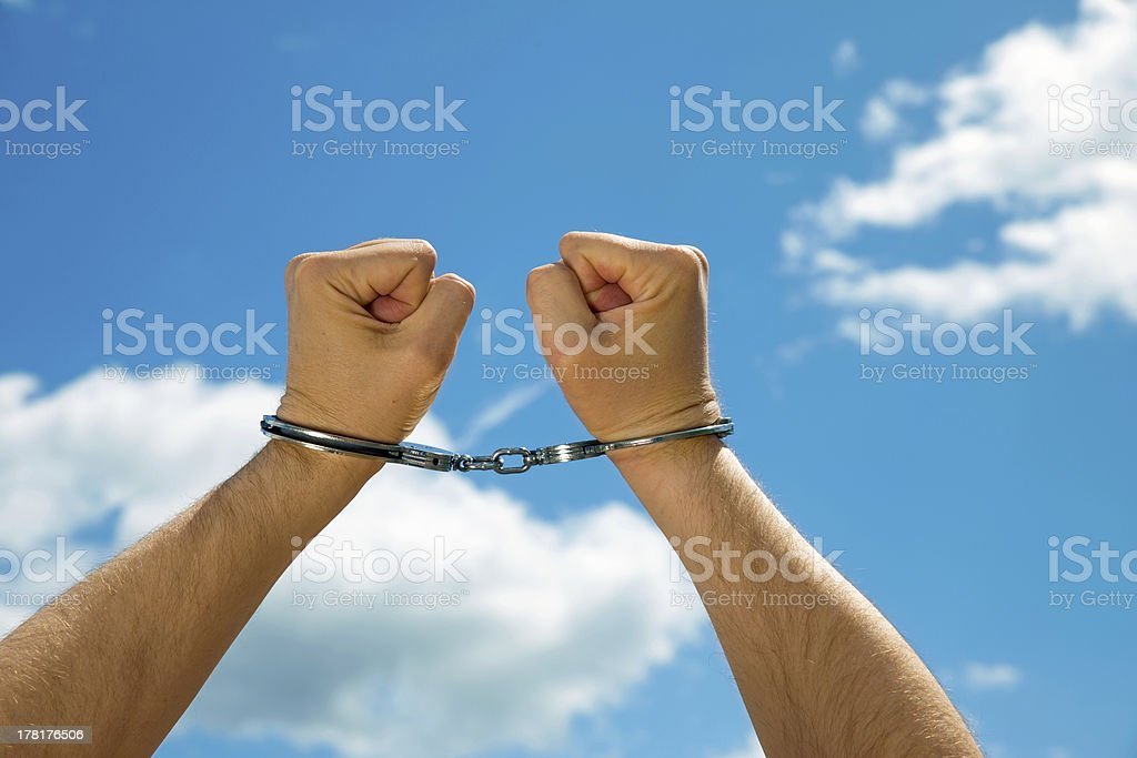 Handcuffed angry Man loosing freedom royalty-free stock photo