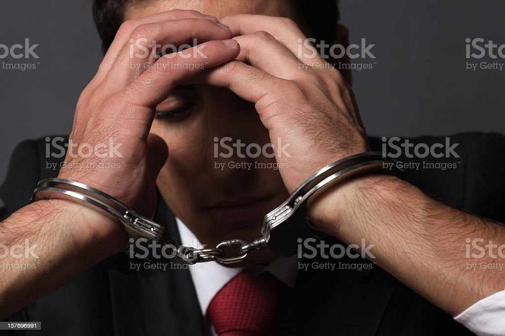 Handcuffed businessman royalty-free stock photo