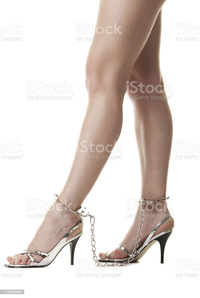 Handcuffed female legs royalty-free stock photo