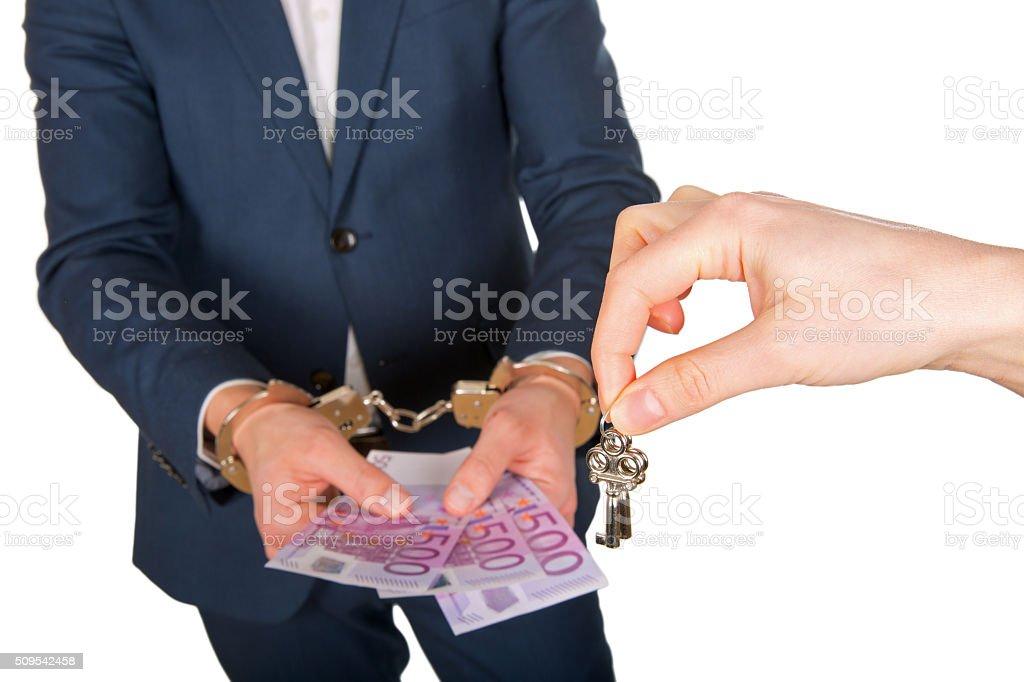 Handcuffed hand stock photo