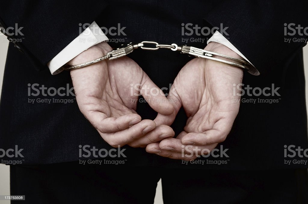 Handcuffed Hands stock photo