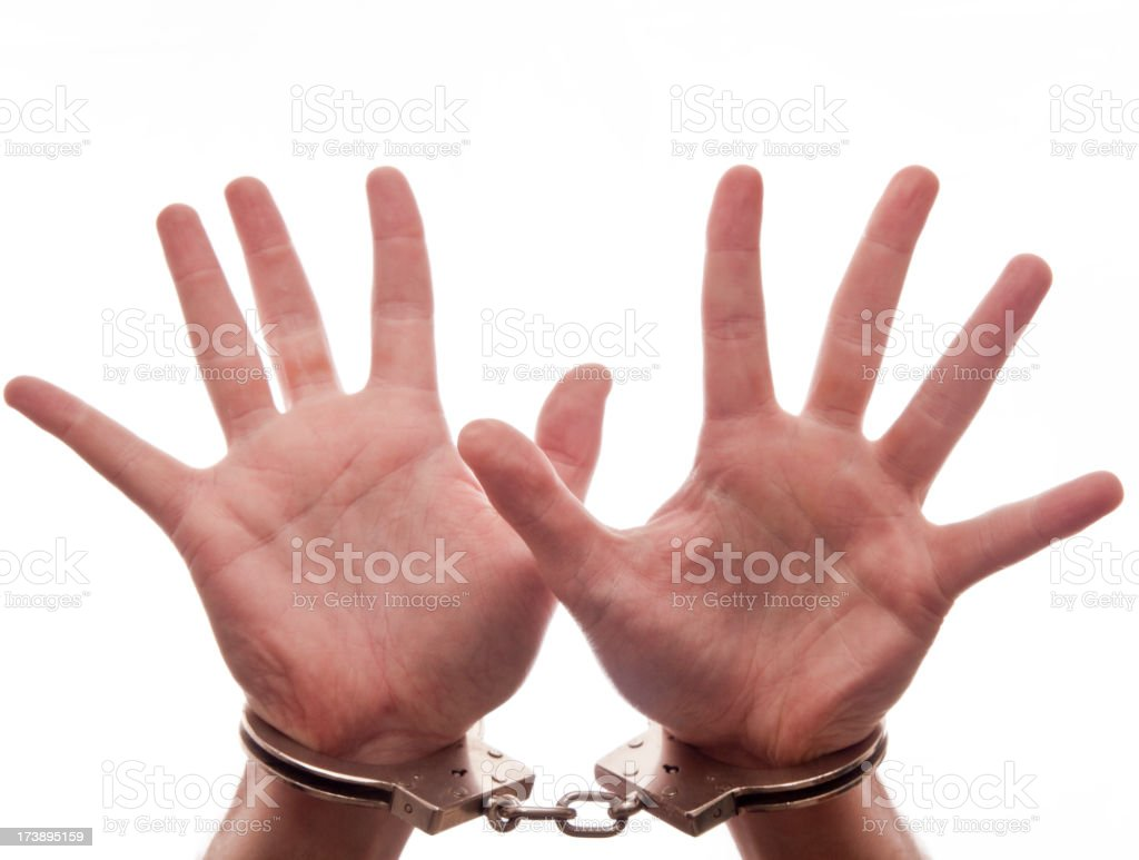 Handcuffed hands with outstretched fingers royalty-free stock photo
