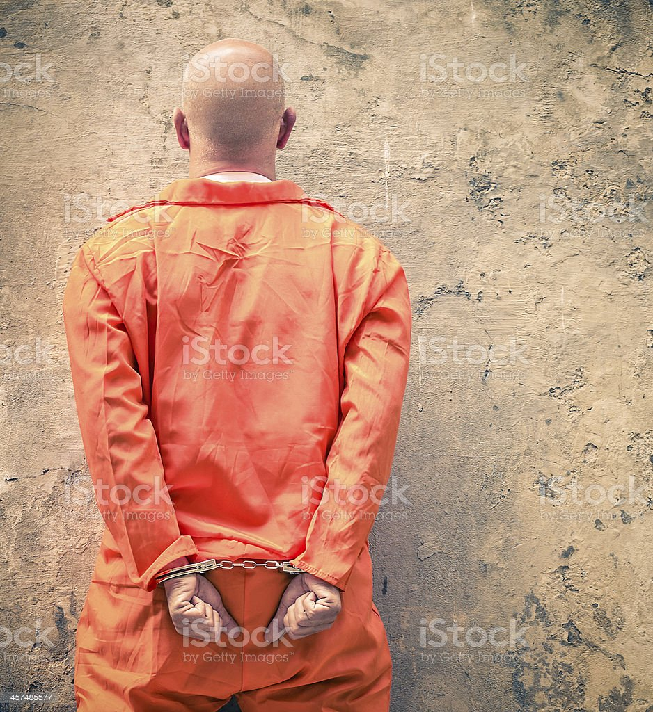 Handcuffed prisioner waiting for death penalty, back view stock photo