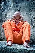 Handcuffed Prisoner in Orange Coveralls