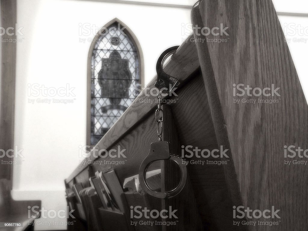 Handcuffed to Religion royalty-free stock photo