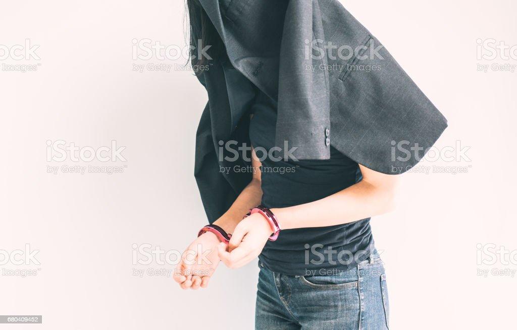 Handcuffed woman stock photo