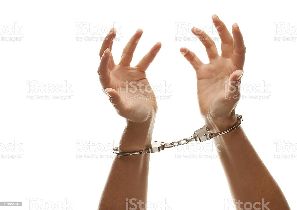 Handcuffed Woman Raising Hands in Air on White royalty-free stock photo