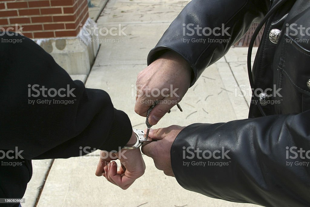 Handcuffing royalty-free stock photo