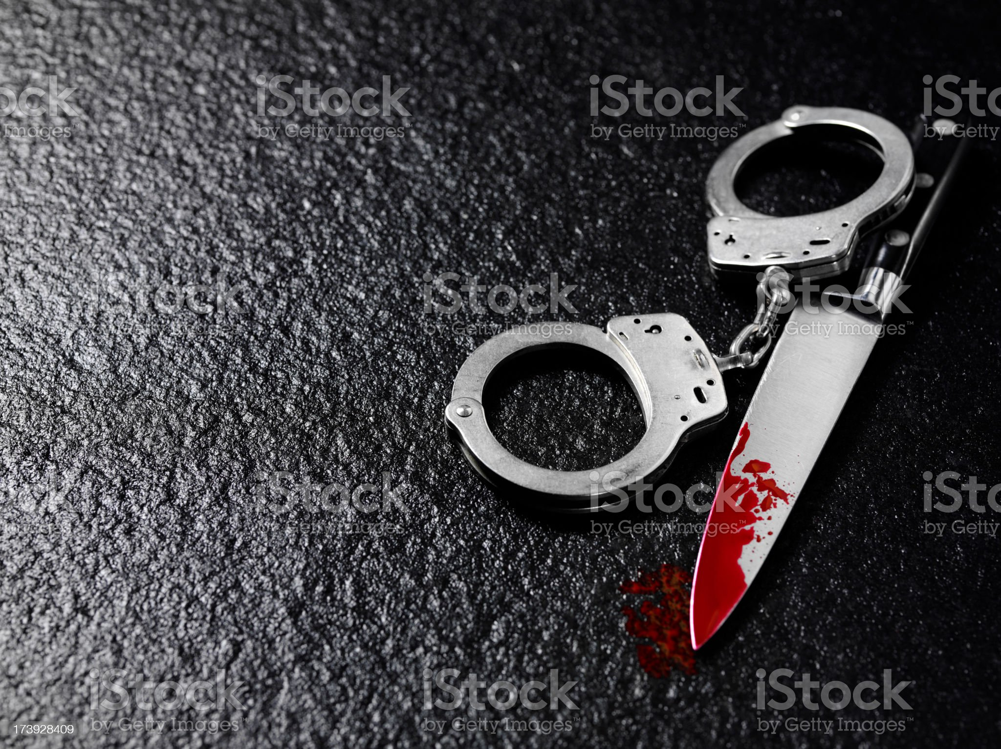 Handcuffs and Blood Stained Knife royalty-free stock photo