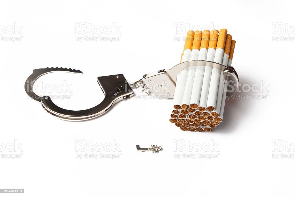 Handcuffs and Cigarettes stock photo