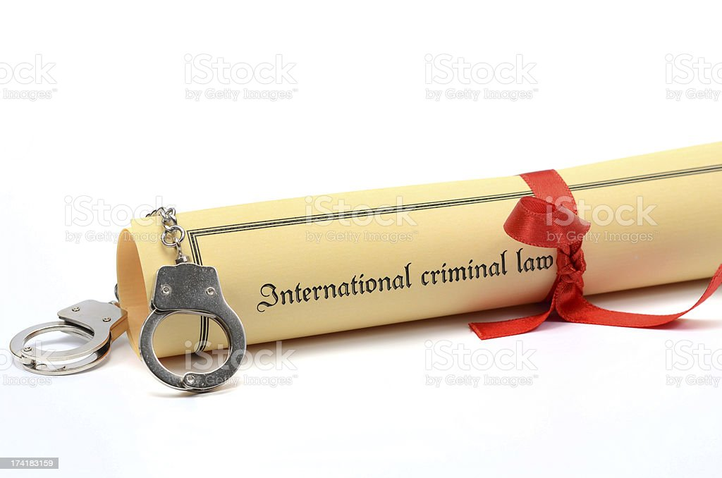 Handcuffs and International criminal law document royalty-free stock photo