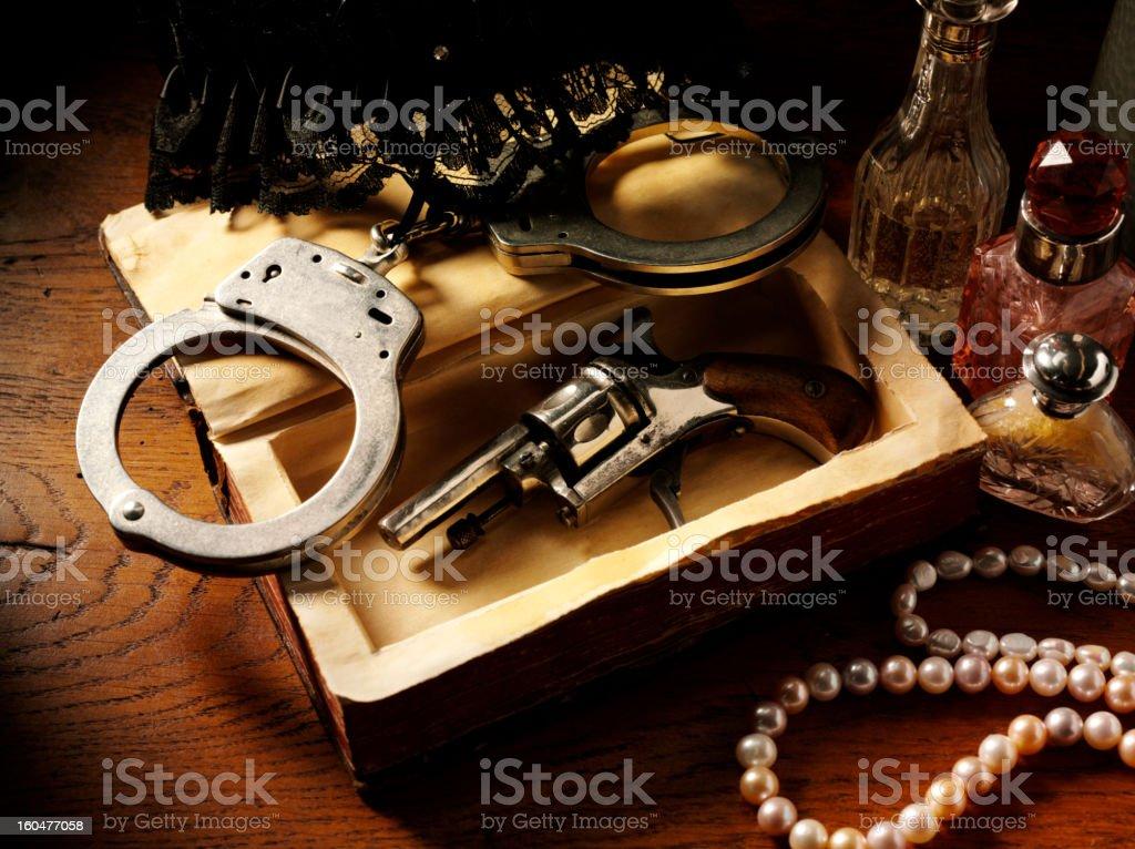 Handcuffs and Vintage Gun stock photo