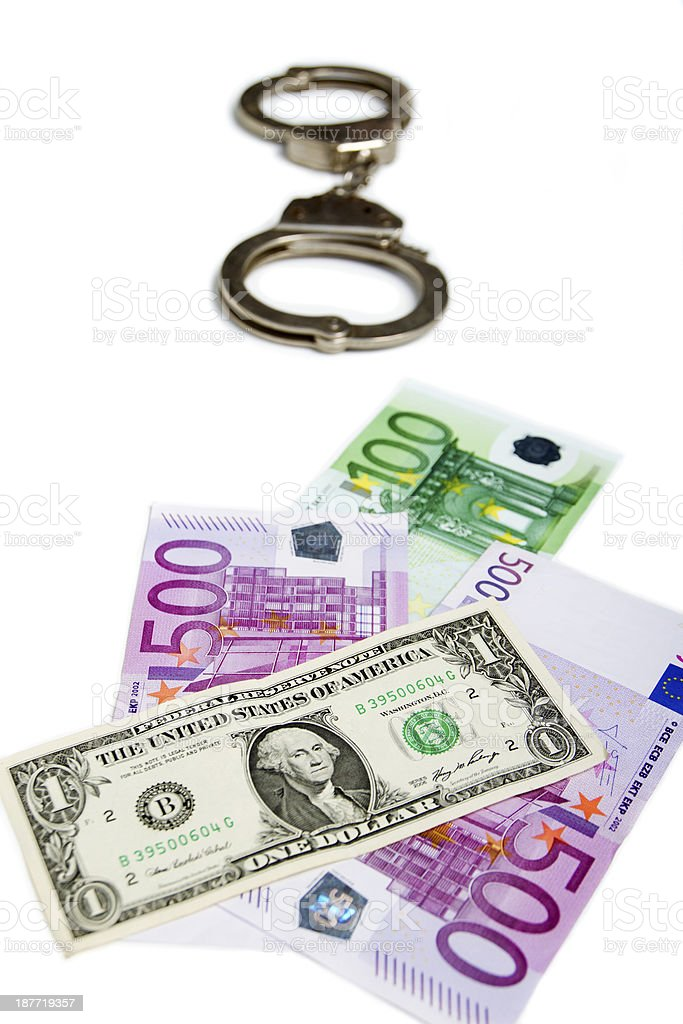 Handcuffs, dollar and euro royalty-free stock photo