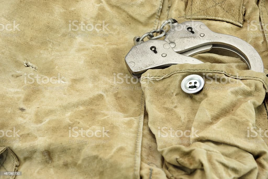 Handcuffs in The Camouflage Army Pants Pocket or Haversack stock photo
