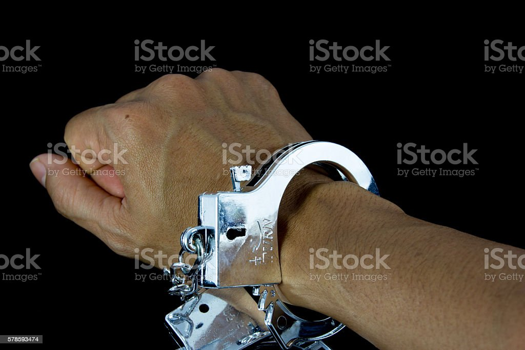handcuffs isolated on black background stock photo