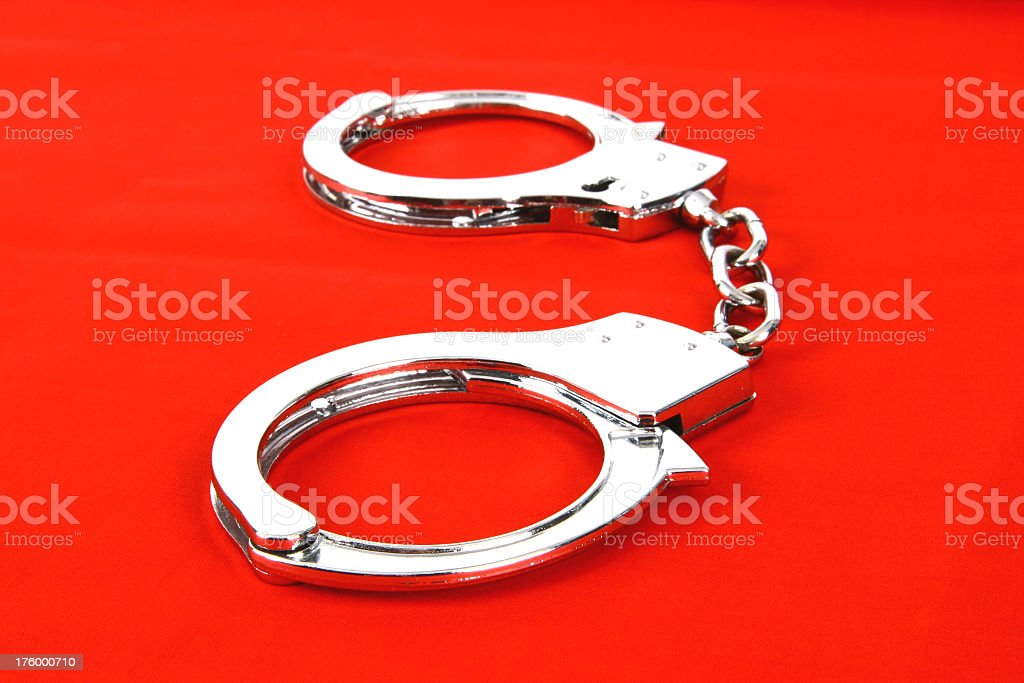 Handcuffs on red royalty-free stock photo