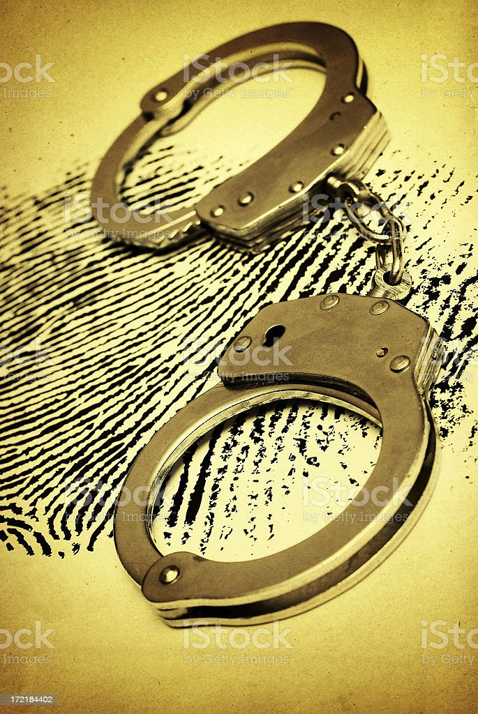 Handcuffs on the Fingerprint royalty-free stock photo