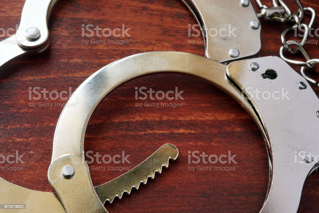 Handcuffs on the table. Punishment and crime conept. stock photo