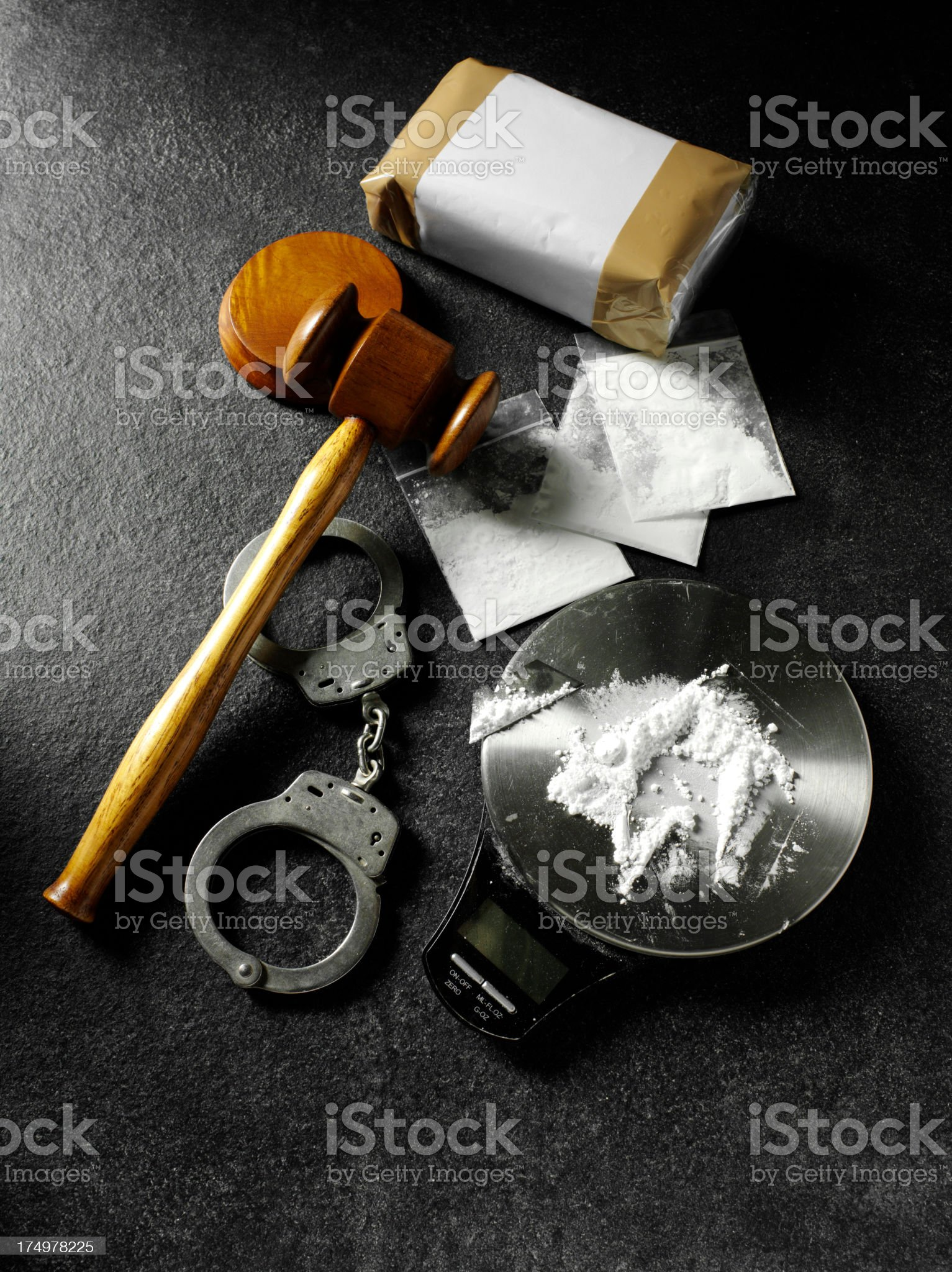 Handcuffs with a Gavel and Drugs royalty-free stock photo