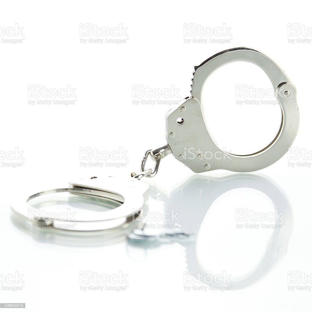 Handcuffs with shadow royalty-free stock photo