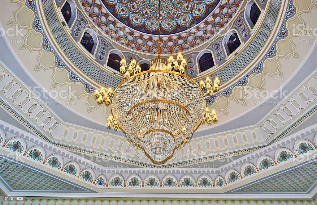 Сhandelier alight is in a large mosque. stock photo