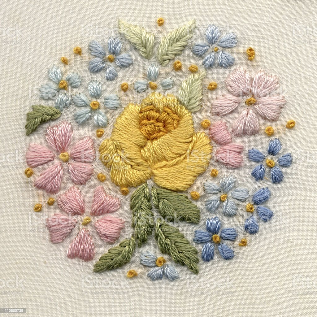 hand-embroidered flower motif stock photo