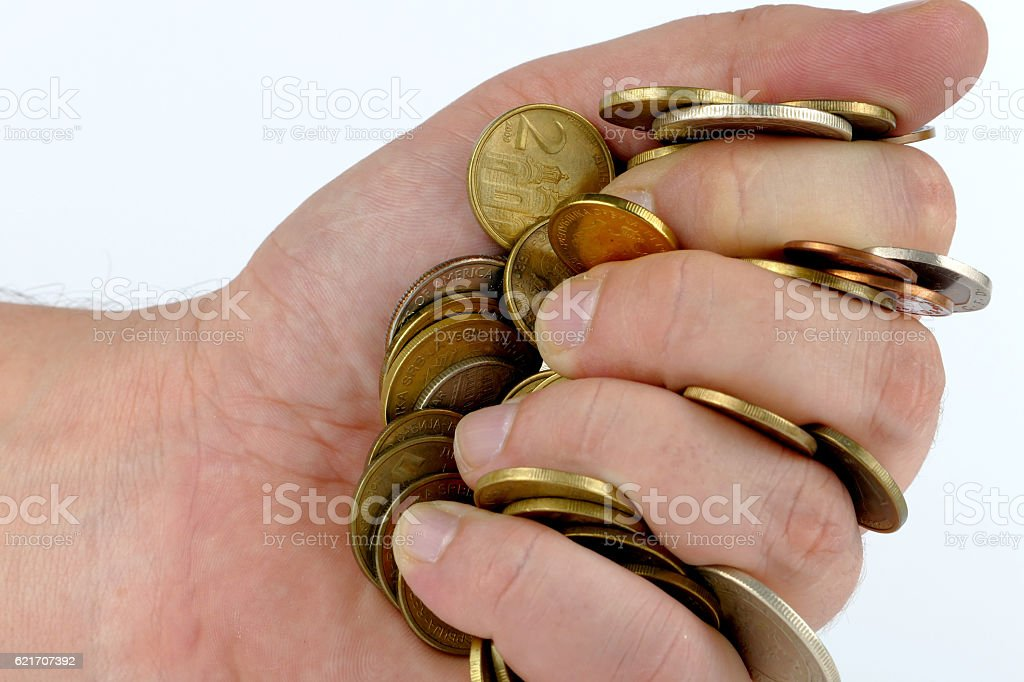 Handful of coins stock photo