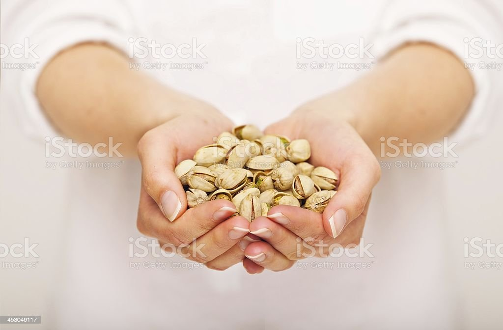 Handful of Crunchy Pistachio Nuts royalty-free stock photo